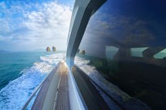 Yacht moving in calm sea and making a wave Royalty Free Stock Photography