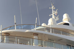 Yacht with multiple decks. Yacht deck irradiated with light of sunset Stock Images