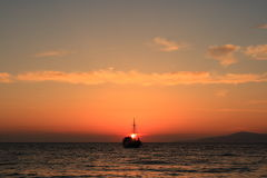 Yacht in Mykonos sunset. Mykonos is a Greek island and a tourist destination, renowned for its cosmopolitan character and its intense nightlife Royalty Free Stock Photos