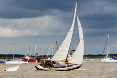 Yacht navigating the river under sail Royalty Free Stock Photography