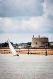 Yacht navigating the river under sail Royalty Free Stock Image