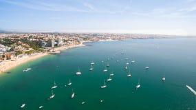 Yacht near beautiful beach and marina of Cascais Portugal aerial view Royalty Free Stock Photo
