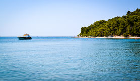 A yacht near in a creek by the coast of Croatia. Huge yacht stays in those creek Stock Images