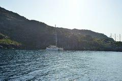 Yacht near Santorini sea coast Stock Photos