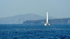 Yacht near Santorini sea coast Stock Photography