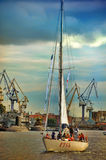 Yacht on the Neva on the background of the port Royalty Free Stock Photography