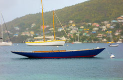 A yacht with no mast in the windward islands Royalty Free Stock Photo