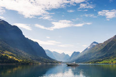 Yacht on Nordfjord. Olden city, Norway Royalty Free Stock Image