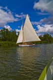 Yacht on the Norfolk Broads. Yacht sailing on the Norfolk Broads Royalty Free Stock Image