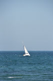 Yacht on ocean. Scenic view of single yacht sailing on ocean Stock Photography