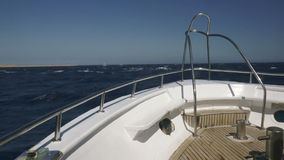 Yacht on the ocean with blue sky and turquoise water stock video