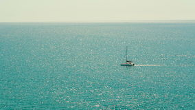 Yacht in the Ocean. Lone boat in the ocean stock video footage