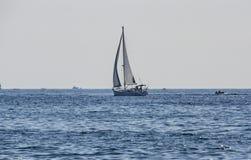 Yacht in ocean waters Stock Photo