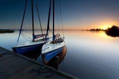 Yacht On Lake Harbor At Sunrise Stock Photo