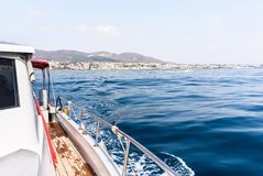 Free Yacht Or Private Luxury Boat Ride. Sailing In The Sea Or Ocean With Motorboat Or Sailboat. View From The Deck To The Coast. Royalty Free Stock Images - 144078139