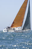 Yacht With Orange Sail Competes In Team Sailing Event Royalty Free Stock Image