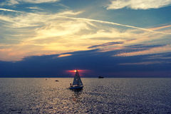 Yacht out to sea at sunset Royalty Free Stock Photo