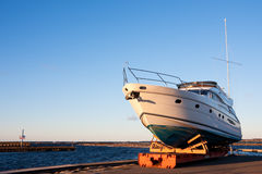 Yacht out of the water. A photo of yacht on a sunny day put out of the sea for winter Stock Photos