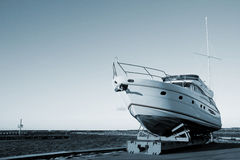 Yacht out of the water. A photo of yacht put out of the sea for winter Stock Photos