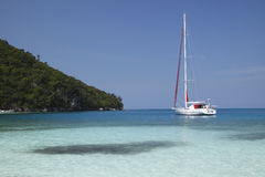 Yacht in paradise. Sits in tropical blue waters of the Caribbean royalty free stock photo