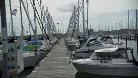 Yacht parking in harbor, harbor yacht club in fehmarn, germany. Beautiful Yachts in cloudy sky background stock video