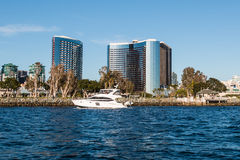 Yacht Passes by Embarcadero and Waterfront Hotels. SAN DIEGO, CALIFORNIA - MARCH 2, 2017: A yacht passes by the Embarcadero and waterfront hotels on San Diego stock images