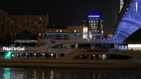 Yacht passes under the bridge on the Moskva River in Moscow. stock video footage