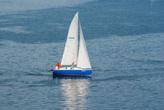 Yacht passing by turning buoy in the sailing race Stock Photos