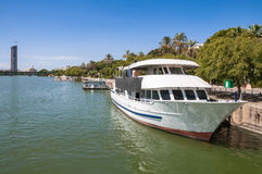 Yacht at a pier on Guadalquivir River in Seville. Spain stock images