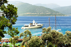 Yacht at the pier on Mediterranean turkish resort Royalty Free Stock Images