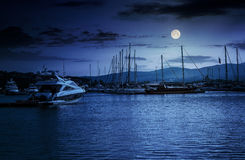 Yacht at the pier  at night. Yacht at the pier of the old city  at night in full moon light Royalty Free Stock Photography
