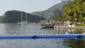 Yacht at the pier and outdoor restaurant on Mediterranean turkish resort stock video footage