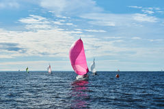 Yacht with pink spinnaker Stock Photo