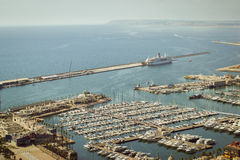 Yacht port of Alicante, Valencia, Spain. ALICANTE, SPAIN - SEPTEMBER 9, 2014: view of the yacht port of Alicante, the castle Santa Barbara, Valencia Spain Royalty Free Stock Photo