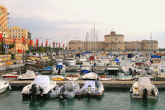 Yacht port and ancient fortress. Civitavecchia, Italy Royalty Free Stock Image