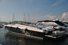Yacht in the port of Saint-tropez. Snow-white  yacht in the port of Saint-tropez on a clear summer day Stock Photos