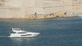 Yacht in the port of Valletta in the island of Malta. Motor yacht in the port of Valletta in the island of Malta stock video