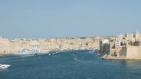 Yacht in the port of Valletta in the island of Malta. Motor yacht in the port of Valletta in the island of Malta stock footage