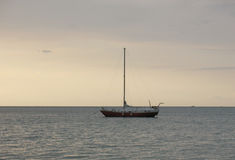 Yacht and quiet sea. At sunset, quiet evening at the sea Royalty Free Stock Image