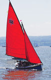 Yacht race 2. The leader in a yacht race skims across the sea stock photography