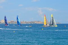 Sailing Yacht Race Around The World In Equal Sail Boats - Close Racing. Four competing yachts at the start of the Volvo Ocean Race, Brunel, Abu Dhabi, Vestas and Royalty Free Stock Image
