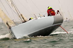 Yacht race at regatta. A yacht race at regatta, see the bow Royalty Free Stock Images