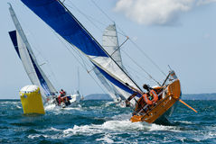 Yacht at race regatta. Group of yacht at race regatta with skipper Royalty Free Stock Photography