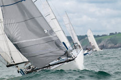 Yacht race in the waves. Yacht at regatta in the waves Royalty Free Stock Photography