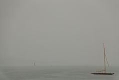 Yacht in rain. Yacht on the Ammersee lake during rain stock image