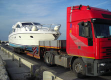 Yacht ready to be transported. In shipyard after summer season Royalty Free Stock Photo
