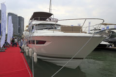 Yacht and red pontoon. Tourist visiting xiamen yacht marina on the red carpet, amoy city, china Royalty Free Stock Images