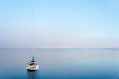 Yacht reflected in calm wate Royalty Free Stock Photos