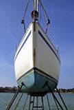 Yacht Repairing. Sailboat on the dry dock to be repaired Stock Photos