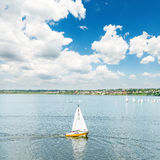Yacht on river and blue sky with clouds Stock Image